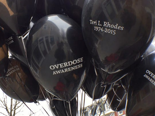 "Black balloons were placed around the Greencastle square on Tuesday, March 6, 2018, to raise awareness for drug addiction and overdose. The ballons have ""Teri L. Rhodes"" and ""1974-2015,"" and ""Overdose Awareness"" written on them"
