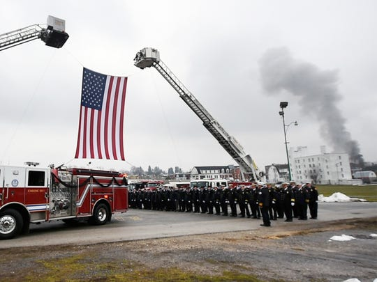 Smoke from a fire can be seen on Highland Ave. in West York as a procession arrives at the York Expo Center for the memorial service for York city firefighters Ivan Flanscha and Zachary Anthony on March 28, 2018.