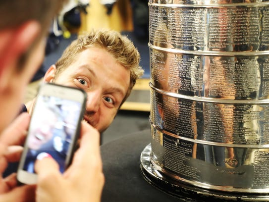 Florida Everblades defenseman, Zack Kamrass takes a selfie with the Stanley Cup on April 26. He hopes to be smiling with the Kelly Cup Saturday night.