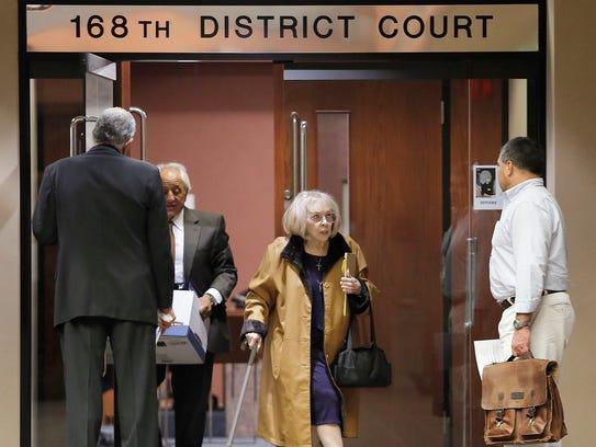 Lisbeth Garrett leaves the 168th District Court on