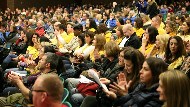 Clarkstown school supporters attend a Clarkstown school board meeting Friday. Some in the community are concerned that an elementary school may have to close.