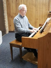 Larry Shields plays piano during a recent rehearsal
