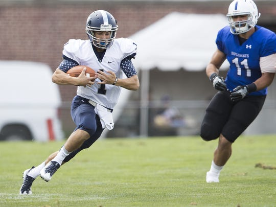 LVC quarterback Tim Pirrone runs for a first down during Saturday's season-opening 30-6 loss at F&M.