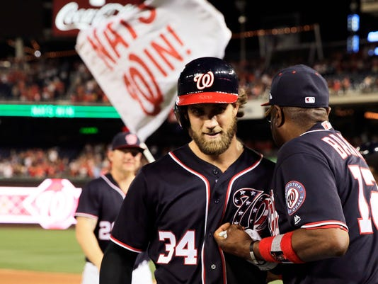 Washington Nationals' Bryce Harper (34) celebrates with manager Dusty Baker, right, following his walkoff RBI-single in the bottom of the tenth inning during against the Cincinnati Reds, Friday, June 23, 2017, in Washington. (AP Photo/Mark Tenally)