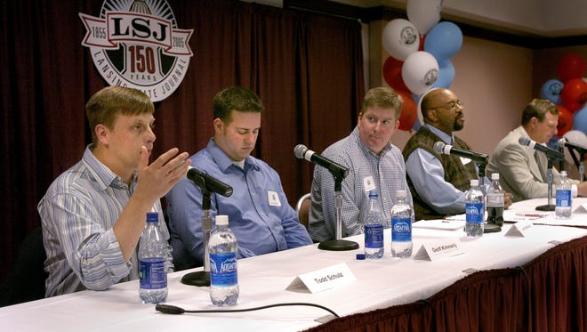 -  -LSJ sports reporters Todd Schulz, Geoff Kimmerly, Joe Rexrode, Ricardo Cooney and WILX-TV 10's Tim Staudt, left to right, answer questions and talk to people at the LSJ sports forum at the Lansing Center Thursday.