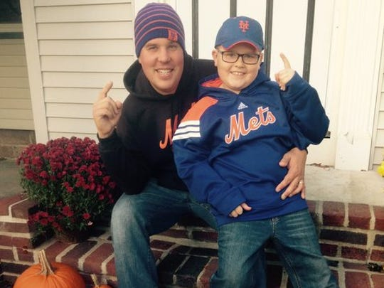 Matt Mroczek, 36, and his son, Colby, 8, have enjoyed the Mets' run to this year's World Series, which starts Tuesday in Kansas City.