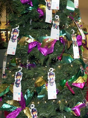 Pensacola News Journal employees have adopted 50 angels from the tree and are looking to our fellow media members and community leaders to finish things off.