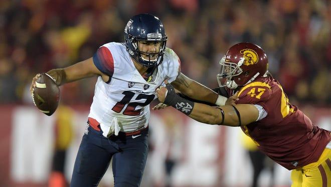 Nov 7, 2015: Arizona Wildcats quarterback Anu Solomon (12) is pressured by Southern California Trojans linebacker Scott Felix (47) at Los Angeles Memorial Coliseum.
