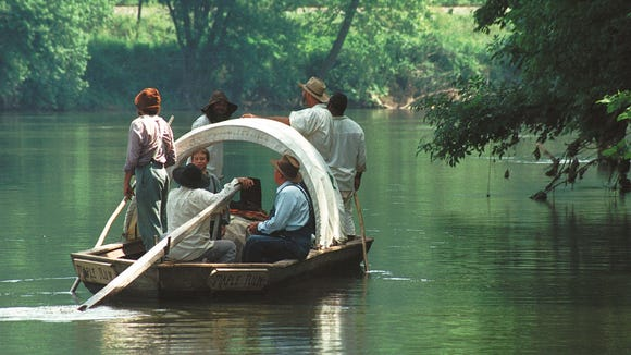 With the James River running calm, the crew of the Maple Run to a moment to relax and take in the scenery during the James River Batteau Festival in 1999.