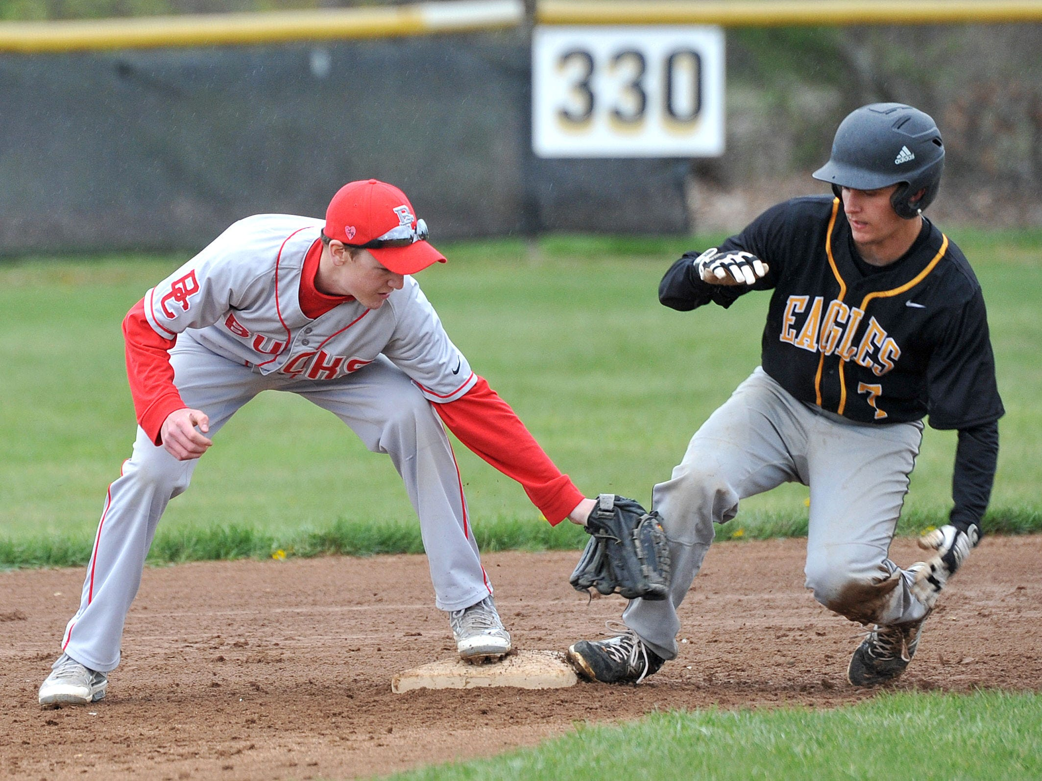 Colonel Crawford's Jake Johnson safely steps onto second base before Buckeye Central's Josh Dentinger can tag him out during their game Thursday evening.