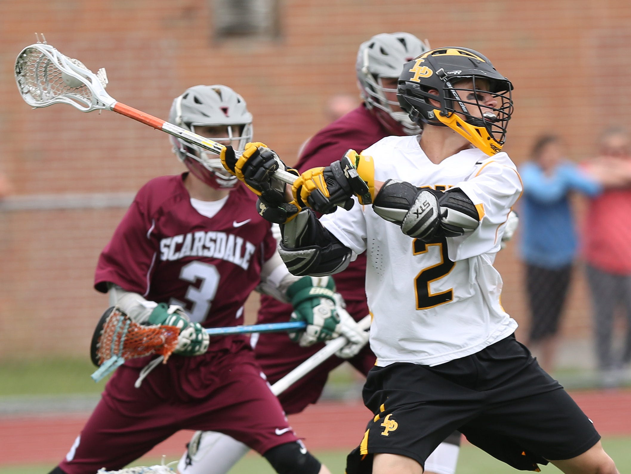 Lakeland/Panas' (2) fires a shot in front of Scarsdale's (3) during second half action in a Section 1 boys lacrosse playoff game at Lakeland High School in Shrub Oak May 21, 2016. Lakeland/Panas won the game 11-7.