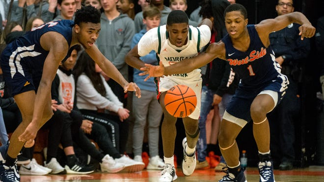 Gary West Side's Quiman Peterson, right, and Billy Muldrew, left, battle Morgan Park's Marcus Watson Jr. for a loose ball in the first half Wednesday, Nov. 27, 2019 at the Tournament of Champions in Washington.