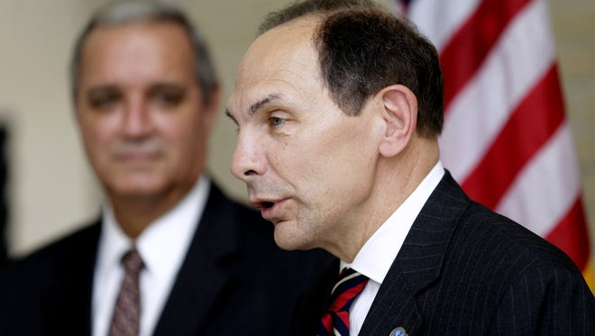 In this photo taken Oct. 1, 2014, Veterans Affairs Secretary Robert A. McDonald, right, accompanied House Veterans Affairs Committee Chairman Rep. Jeff Miller, R-Fla., speaks in Tampa, Fla. Fewer veterans are taking advantage of a new law aimed at making it easier for them to get private health care and avoid the long waits that plagued  VA facilities nationwide. In fact, so few veterans are signing up for the much-ballyhooed Choice cards that allow access to private health care that the Veterans Affairs Department says it wants to redirect some of the $10 billion Congress allocated for the program. Republicans say the VA should do a better job selling the choice program. Lawmakers also want to address a quirk in the law that makes it harder for veterans in rural areas to prove they live at least 40 miles from a VA clinic. The government measure the distance as the crow flies, rather than driving miles, leaving thousands of veterans out of the choice program.