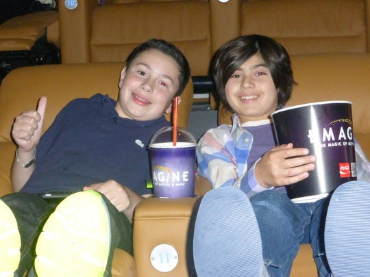 Thirteen-year-old friends Benny Shaevsky of West Bloomfield and Elliot Kaftan of Birmingham enjoy the good life at Emagine Palladium with cushy leather power recliner seats and unlimited popcorn.