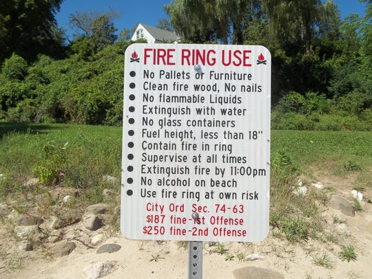 Rules posted near beach fire pits in Sheboygan were