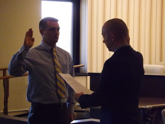 New Richmond Police Department officer Ryan Gray is sworn in by Mayor Dave Snow.