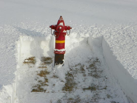 This is how snow should be cleared from a fire hydrant.