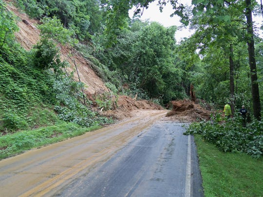 Two state workers were clearing a small landslide in