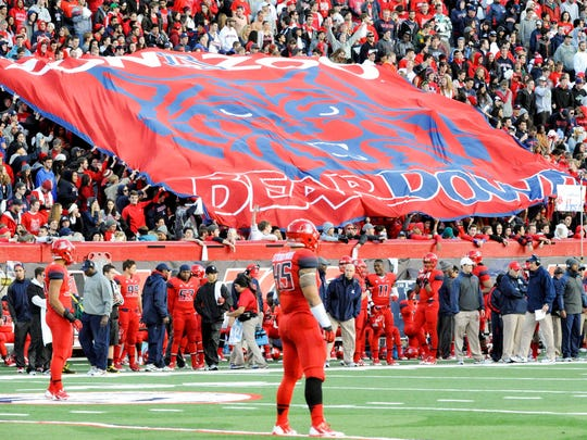 Students in the Arizona Wildcats zona zoo section display a flag during the third quarter against the Oregon Ducks at Arizona Stadium.