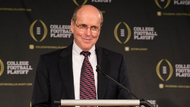 College Football Playoff executive director Bill Hancock and colleagues announced Monday the plan for revealing the inaugural championship semifinal matchups.
