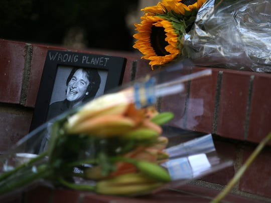 "Flowers and pictures that are part of a memorial on the steps in front of the home where Robin Williams filmed ""Mrs. Doubtfire"" in San Francisco. The Academy Award-winning actor and comedian was found dead in his Marin County home on Monday of an apparent suicide. He was 63 years old."