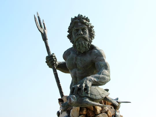 A statue of King Neptune, the mythical sea god, stands watch over the oceanfront in Virginia Beach, Va. The 34-foot statue is a popular selfie spot. Virginia Beach's wide oceanfront beaches are popular with tourists. They're one of a number of free things to do and see in Virginia's largest city.