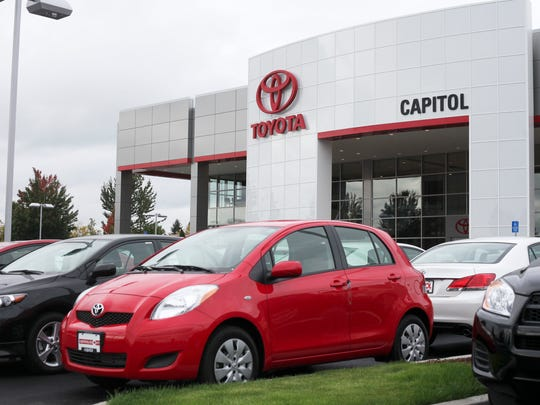 Employees of Capitol Toyota move hundreds of cars from the old location on Misson St. SE to the new one along Salem Parkway on Sunday, Oct. 9, 2011.