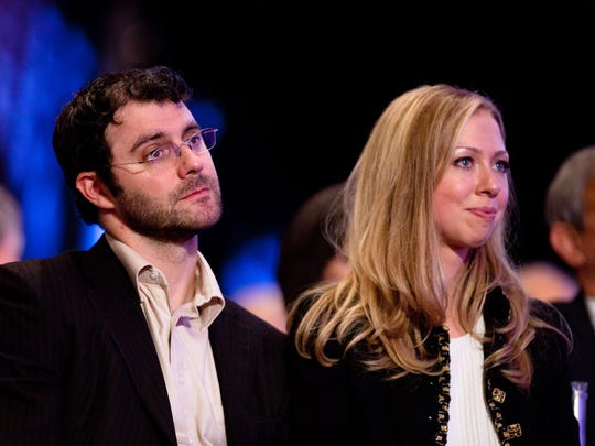 Chelsea Clinton with her husband.