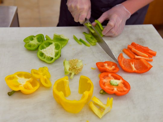 <137,2014/06/12,Yilek/c Caitlin1>St. Cloud Technical & Community College culinary arts graduate<137> Josh Croson slices red, yellow and green bell peppers <137,2014/06/12,Yilek/c Caitlin1>on<137> <137>Saturday, <137>May 31 at the Sauk Rapids Coborn's Superstore.