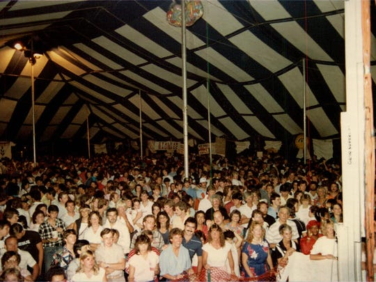 A crowd gathers in the Downtown Festival Tent circa 1985 for a concert by The Skycoasters.