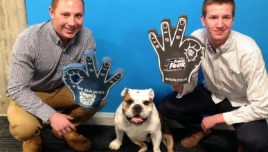 Brian Todd (left) and Brian Straughn, both Butler University sophomores, show off the Thringers with mascot Trip.