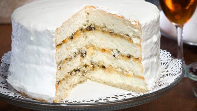 """Lane cake is a dessert made with white sponge cake, raisins, and whiskey. It was invented by Emma Rylander Lane of Clayton in Barbour County. She first printed the recipe in her 1898 self-published cookbook, """"Some Good Things to Eat."""""""
