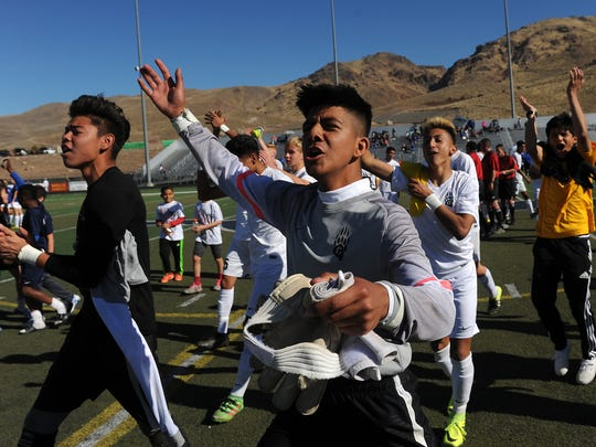 Galena celebrates after defeating Carson City 1-0 to win the  Northern Region 4A boy's soccer championship at Damonte Ranch on Saturday.