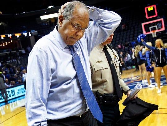 Dejected University of Memphis head coach Tubby Smith