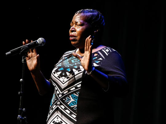 "Sarah Carpenter, a leader of Memphis Lift speaks to audience member during Gannett's ""I am an American"" storytellers event at the Halloran Centre for Performing Arts on September 20, 2017."