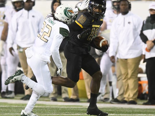 Souther Miss wide receiver Korey Robertson gains extra yards in a game against UAB on Saturday at M.M. Roberts Stadium.