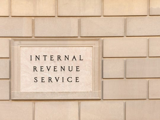 Brick wall with plaque reading Internal Revenue Service.