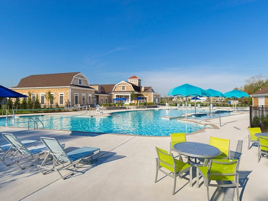 Relax by the pool on the outdoor patio at the Clubhouse