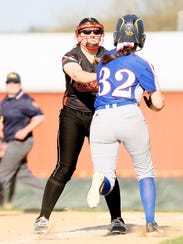 Spring Grove's Bailey Rapson, right, is out at first