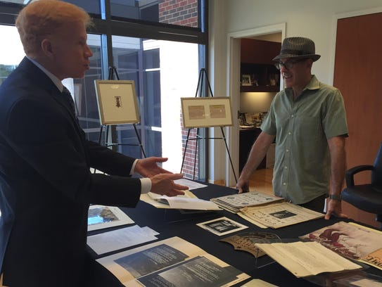 Gordon (right) looks at documents and photos with Rabbi