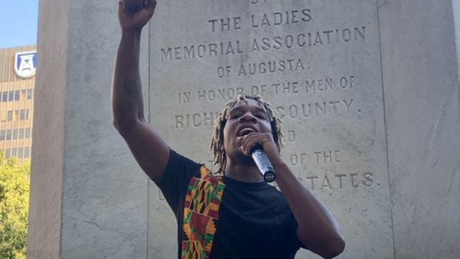 Que McQueen of BLACC calls for the removal of the Augusta Confederate Monument during a protest in front of the monument on Broad Street Friday, Oct. 16.