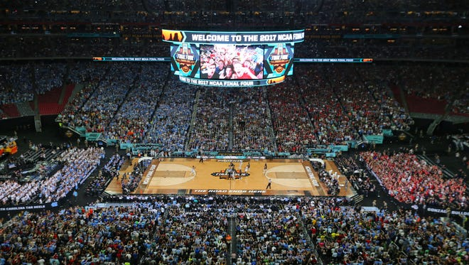 The opening tip-off of the NCAA National Championship game between North Carolina and Gonzaga is seen from above at University of Phoenix Stadium in Glendale on Monday, April 3, 2017.