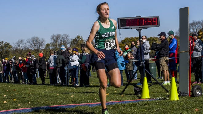 Peoria Notre Dame's Maria Stedwill crosses in first place in the Class 2A girls cross country sectional Saturday, October 31, 2020 at Detweiller Park in Peoria.