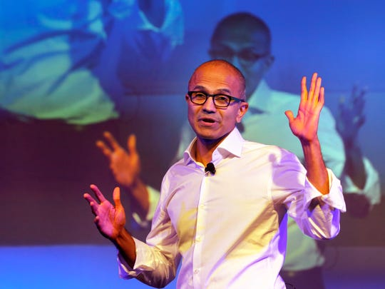 In this Tuesday, Sept. 30, 2014 file photo, Microsoft Chief Executive Officer Satya Nadella speaks to students in New Delhi. On Thursday, Oct. 9, 2014, Nadella spoke at an event for women in computing held in Phoenix, saying women don't need to ask for a raise. They should just trust the system. He was asked to give his advice to women who are uncomfortable requesting a raise.