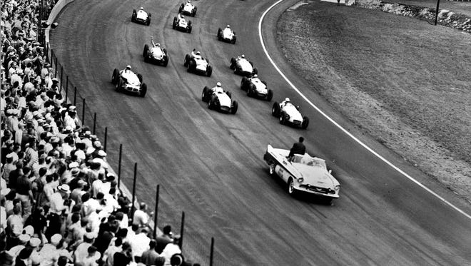 "Pacing the pack at the start of the 1956 race is the DeSoto Fireflite driven by L. I. Woolson, president of the DeSoto Division of Chrysler Corp. ""The picture was taken as the cars went into the southwest turn."