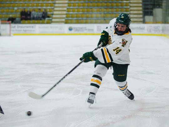 Catamount forward Ali O'Leary (14) takes a shot during the women's hockey game between the Northeastern Huskies and the Vermont Catamounts at Gutterson Fieldhouse on Friday night January 26, 2018 in Burlington.