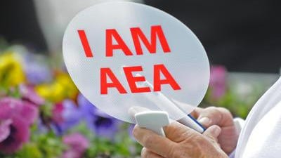 An Alabama Education Association member holds up a fan during an AEA rally at the State House on March 18, 2014. Two members of the AEA Board of Directors sued last week, seeking to end the NEA trusteeship of the group.
