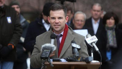 "Ryan Messer  with the group ""We Believe in Cincinnati"" speaks during a pro-streetcar rally in front of Cincinnati City Hall on Monday, December 9, 2013."
