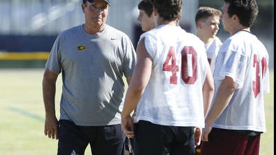 Mountain Pointe football coach Norris Vaughan doesn't feel there is a need for 2-a-days and get-away camps with all of the work put in year-round.