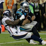 Denver Broncos' DeMarcus Ware (94) sacks Carolina Panthers' Cam Newton (1) during the second half of the NFL Super Bowl 50 football game Sunday, Feb. 7, 2016, in Santa Clara, Calif. (AP Photo/Gregory Bull)